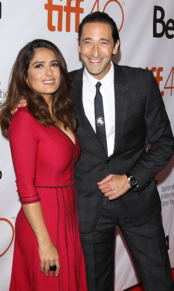 September 15: Say cheese! Salma Hayek and Adrien Brody were all smiles during the 'September Shiraz' screening at the Toronto International Film Festival. 