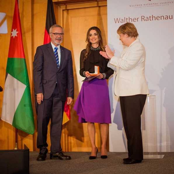 Queen Rania of Jordan is honored for her efforts on behalf of children and refugees, receiving the Walther Rathenau Award from German Chancellor Angela Merkel as Walther Rathenau Institute Chairman Werner Hoyer looks on.<br>