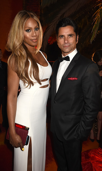 September 20: Laverne Cox changed out of her blue dress and into a just as stunning white one for the HBO party where she hung with John Stamos.