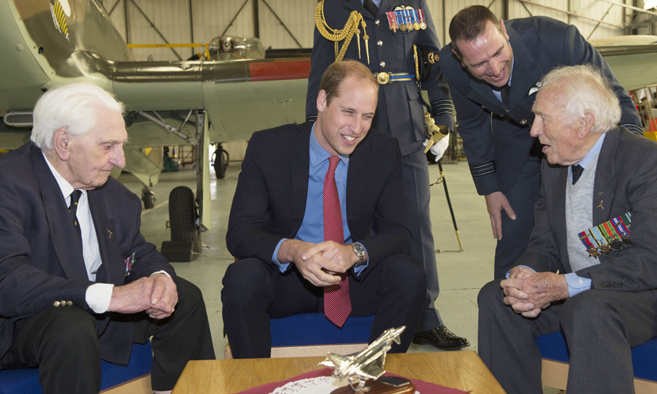 Prince William spoke to Battle of Britain Spitfire pilot Squardon Leader Tony Pickering during a visit to the RAF station to observe the 100th Anniversary Parade of 29 (Reserve) Squadron.