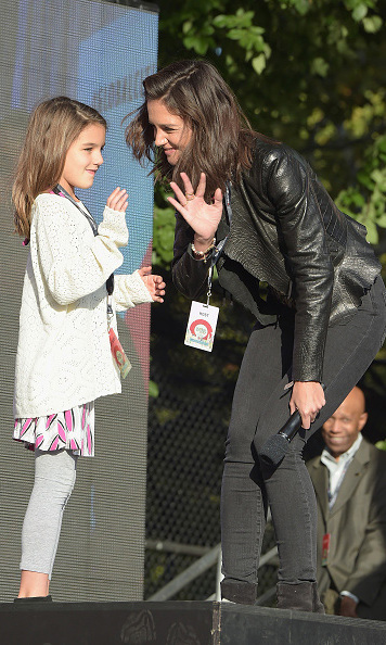 Like mother like daughter! Katie Holmes shared the stage with her mini global citizen Suri Cruise.