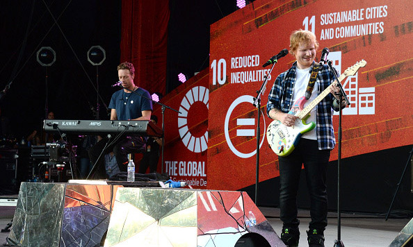 "Coldplay's Chris Martin joined Ed Sheeran on stage during a performance of his hit ""Thinking Out Loud.""