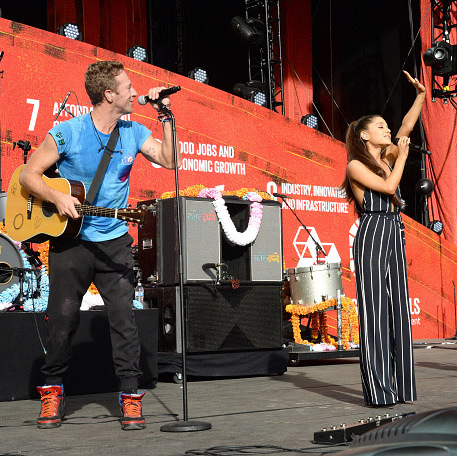 "Ariana Grande was the first surprise of the day when she joined Coldplay on stage for a performance of  ""Just A Little Bit of Your Heart.""