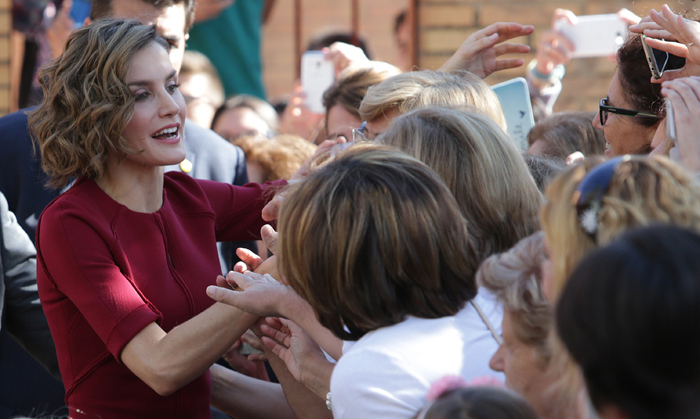 Queen Letizia stopped to talk and take photos with people waiting outside as she supported a vocational training course in Spain. 