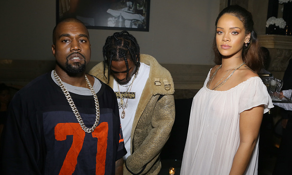 October 3: Rihanna with Travis Scott and Kanye West caught up at the Vogue 95th anniversary celebration in Paris.