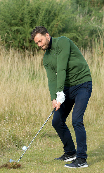 October 3: Fifty swings of Grey! Irish heartthrob Jamie Dornan showed his form on the green during the 2015 Alfred Dunhill Links Championship in Kingsbarns, Scotland.
