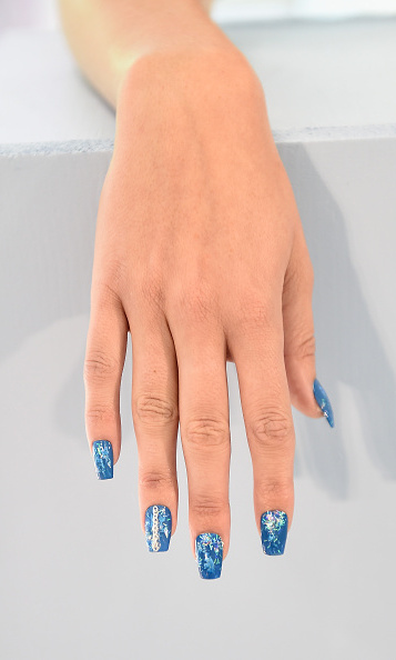 For designer Alexander Lewis' collection at London Fashion Week, Lyndsay McIntosh designed cool blue nails using Bobbi Brown nail color. <br>