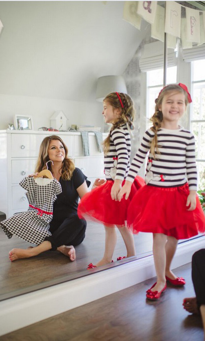 October 5: Tiffani Thiessen and her daughter Harper had fun playing dress up with some of the clothes from Gymboree's Olivia for Gymboree collection. 