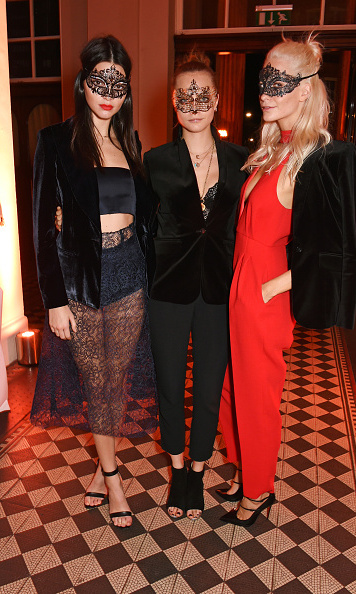 October 9:  Kendall Jenner, Cara Delevingne and Poppy Delevingne were masked beauties at Eva Cavalli's birthday celebration at One Mayfair in London.