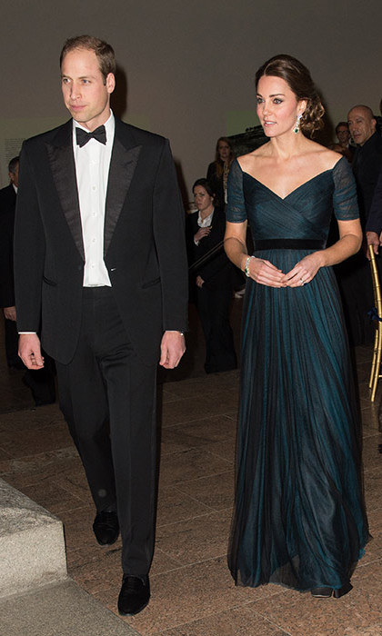 Kate may have been expecting her second child, but she revisited a pre-pregnancy favorite during her official tour of New York City with Prince William in December 2014. Kate wore this stunning dark blue Jenny Packham gown for the St. Andrews 600th Anniversary Ball.<br><br>