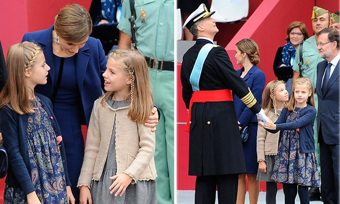 Princesses Leonor and Sofia of Spain got some reassurance from their parents King Felipe and Queen Letizia during their country's National Day celebrations.<br>