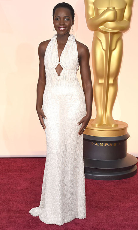 February 2015: Lupita's luxe look for the 87th Academy Awards was a custom Calvin Klein Collection pearl and ivory beaded dress.