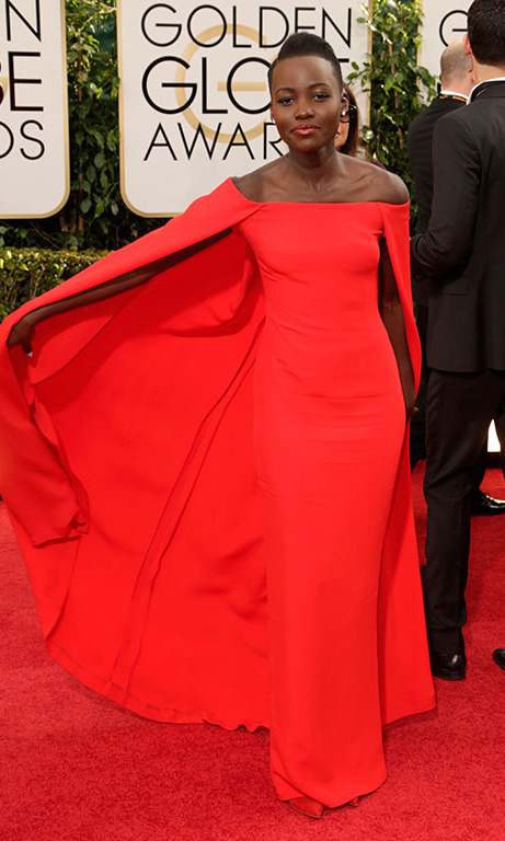January 2014: Ralph Lauren to save the day! Lupita was fierce in her Ralph Lauren cape dress that earned her plenty of her 'best dressed' honors at the 2014 Golden Globes.  