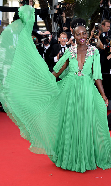 "May 2015: Gucci with extra flare! Lupita had fun with her ""grasshopper green"" Gucci dress at the Cannes Film Festival. 
