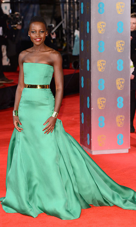 February 2014: Dior girl! Lupita stunned in a sleek green gown by the designer, during the British Academy film awards in London.