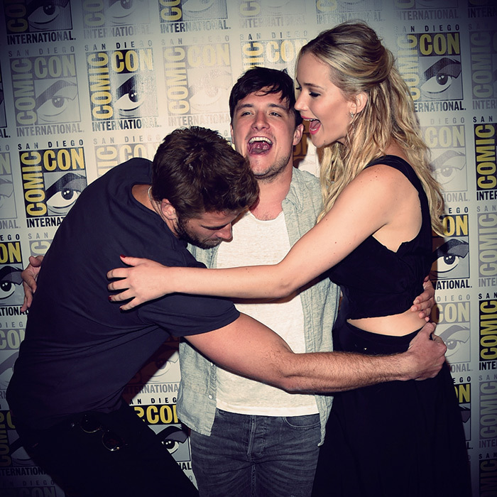 The close-knit cast of the 'Hunger Games' will say farewell to the franchise in November. Here, Jennifer cuddled up with co-stars Liam Hemsworth (L) and Josh Hutcherson at 2015's Comic-Con convention in San Diego.