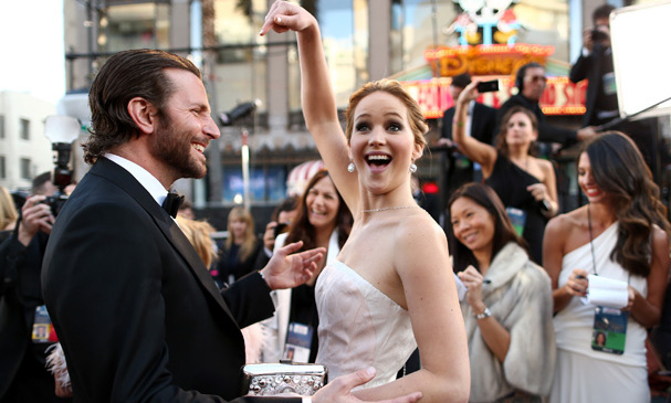 At the 2013 Oscars, we got a glimpse of how much fun Bradley Cooper must have had filming 'Silver Linings Playbook' with Jennifer. The statuesque blonde pointed jauntily at the actor while the two were on the red carpet.
