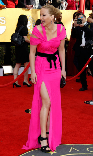 Another day, another nomination for 'Winter's Bone.' We want to know what's happening off camera to give the 23-year-old such a chuckle, but one thing's for sure: We are as in love with this hot pink Oscar De La Renta gown as we are with her easy smile.