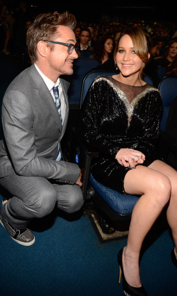 Robert Downey Jr. knew to pop a squat near Jennifer for a fun chat at the People's Choice Awards in January 2013. Both actors took home a number of awards, he for 'Iron Man' and she for 'The Hunger Games.'