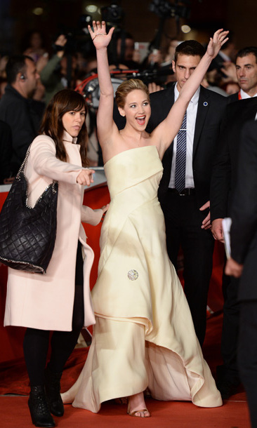 Her creamy yellow Dior gown and elegant, swept-back 'do at the Rome Film Festival in Nov. 2013 were definitely the trappings of a lady, but Jennifer's exuberant pose is giddy girl all the way.