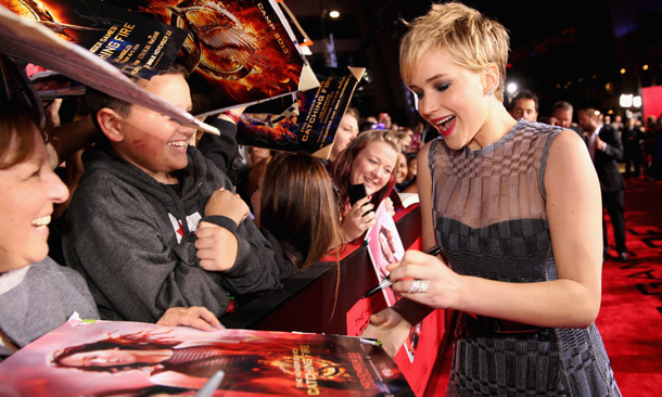 With her new spunky hair and a sheer-ly fabulous Dior Haute Couture gown, the girl on fire took time to sign autographs, chat with fans and, it appears, crack a few jokes.