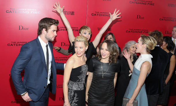 "We smell a trend. Another variation on Jennifer's ""hands up"" pose, which cracked up fellow 'Catching Fire' star Jena Malone at the film's New York City premiere.