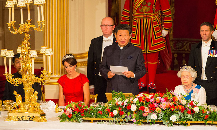 The color of her dress was a perfect nod to her guests' home country. Red is not only the color of China's flag but an important color in their culture, symbolizing good fortune and joy. <br>
