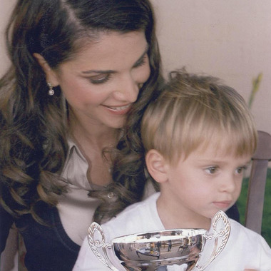 "Queen Rania of Jordan shared the cutest #Throwback pic of Prince Hashem, captioning it ""My little champion, throwback to his first trophy in 2008.""