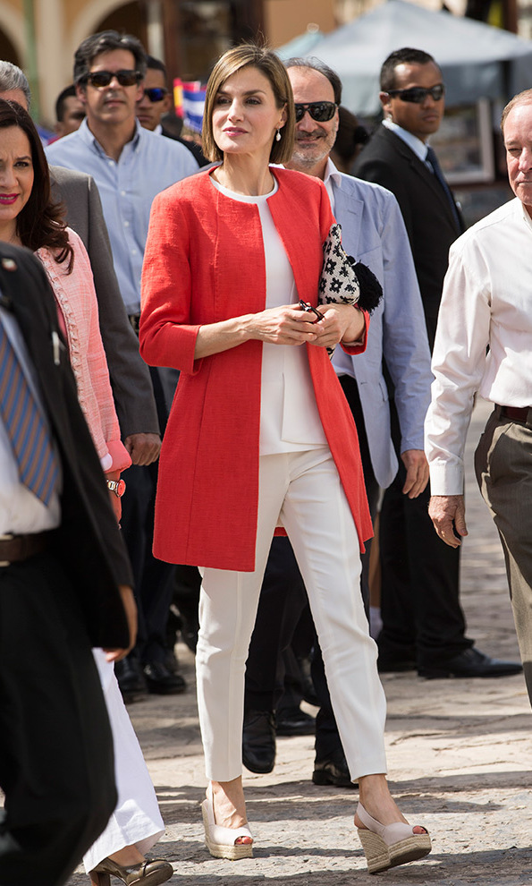 Letizia headed to Hondurus in May 2015 where she adapted her pants style to her busy schedule - here combining slim fitting white pants with wedge sandals.