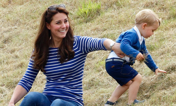 Kate couldn't help but laugh when she played with George during the Gigaset Charity Polo Match at the Beaufort Polo Club. 