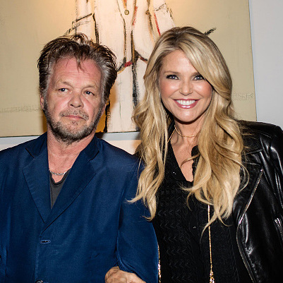 October 21: Date night! John Mellencamp and Christie Brinkley made their first official public appearance together at the Isolation of Mister art exhibit opening in New York City.