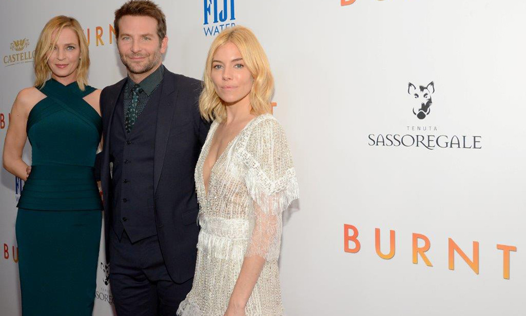 October 20: Cooking something hot! Bradley Cooper, Sienna Miller and Uma Thurman stunned at the New York premiere of 'BURNT' presented by Fiji Water and The Weinstein Company.
