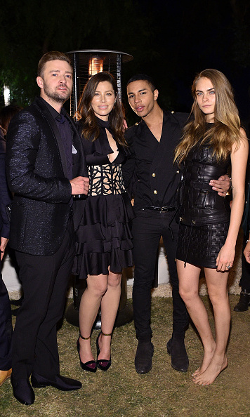October 23: Cara Delevingne had enough of her shoes during Balmain's Creative Director Olivier Rousteing's 30th birthday celebration with Jessica Biel and Justin Timberlake in L.A.