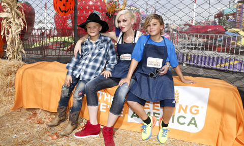 October 24: Gwen Stefani with her two oldest sons Kingston and Zuma helped out during the Feeding America Holiday Harvest event at Shawn's Pumpkin Patch in L.A.
