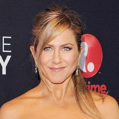 Jennifer Aniston was as radiant as ever with her hair tied back into a super sleek style, with a loose side fringe.