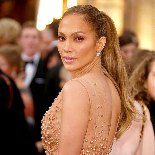 Not one hair was out of place in Jennifer Lopez's glamorous, long tousled hairstyle as she arrived at the 2015 Oscars. <br>