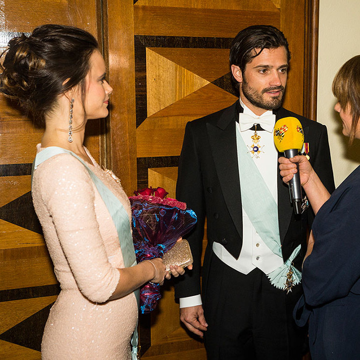 As Prince Carl Philip of Sweden took on a reporter's questions, his pregnant wife Princess Sofia showed off her tiny baby bump at The Royal Swedish Academy of Engineering Sciences' gala in Stockholm.