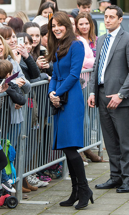 The Duchess really loves a tailored blue coat! During a visit to Dundee, Scotland, she paid tribute to local talent by wearing this design by homegrown label Christopher Kane. <br>
