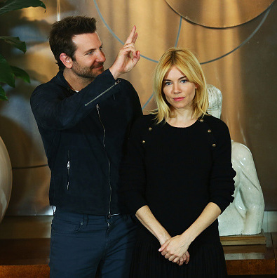 October 27: Bradley Cooper and Sienna Miller had some fun during the 'Burnt' photo call in Rome. 