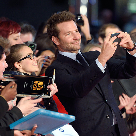 October 28: Bradley Cooper snapped a selfie with excited fans at the premiere of 'Burnt' in London.