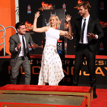 Hands up! Jennifer Lawrence along with her 'Mockingjay Part 2' co-stars Josh Hutcherson and Liam Hemsworth made the most of their hand and footprint ceremony at the TCL Theatre in Hollywood.