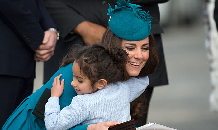 Never one to turn away a tiny admirer, the Duchess of Cambridge shared a hug with a little girl at Dunedin airport during her visit to New Zealand in 2014. 