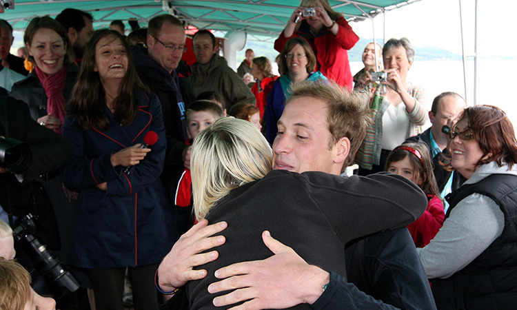 Eager mom-of-one Jo Holmes stole a hug from Prince William during the senior royal's visit to Ullswater in 2009. The Duke of Cambridge joined the charity WellChild for a sail around the the town's lake in a giant steamer boat. 