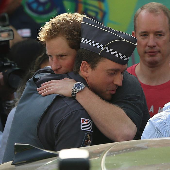 During Prince Harry's tour of Brazil in 2014, the young royal shared a special moment with a policeman as he visited an at-risk community in Sao Paulo.