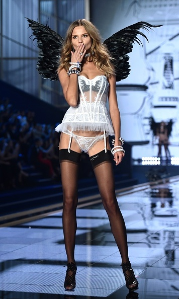 Polish model Magdalena Frackowiak blew a kiss at the 2014 Victoria's Secret show.