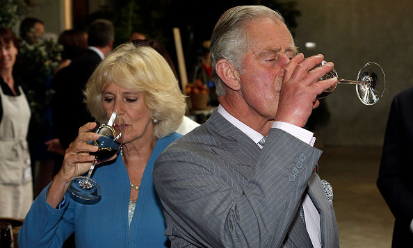 Royals are just like us...they make time for happy hour! Prince Charles and the Duchess of Cornwall taste wine at the Mahana Winery in Nelson, New Zealand.