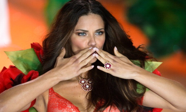 Adriana Lima prepared to send a kiss down the runway at the 2012 show.