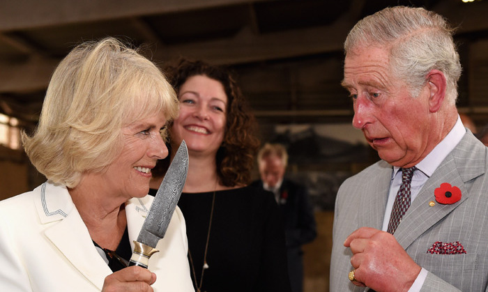 """Behave yourself"" jokes Camilla as she brandishes a knife at her husband Charles at Seppeltsfield Winery. <br>