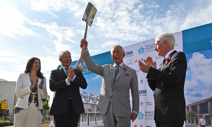 The next-in-line to the British throne raises the spade after turning the first soil at a sustainable urban development in Adelaide.<br>