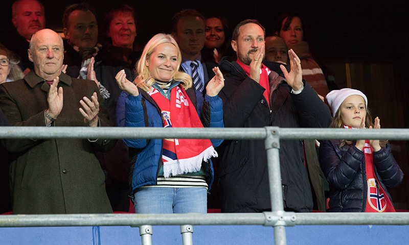 Well played! From left to right, King Harald V of Norway, Crown Princess Mette-Marit, Crown Prince Haakon and Princess Ingrid Alexandra cheer from the stands during a soccer match between Norway and Hungary in Oslo. 